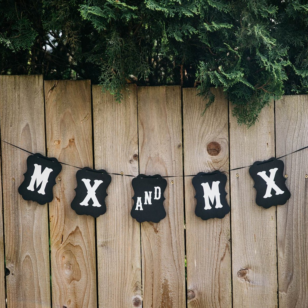Mx and Mx Black Craft Banner Hanging from Wooden Fence