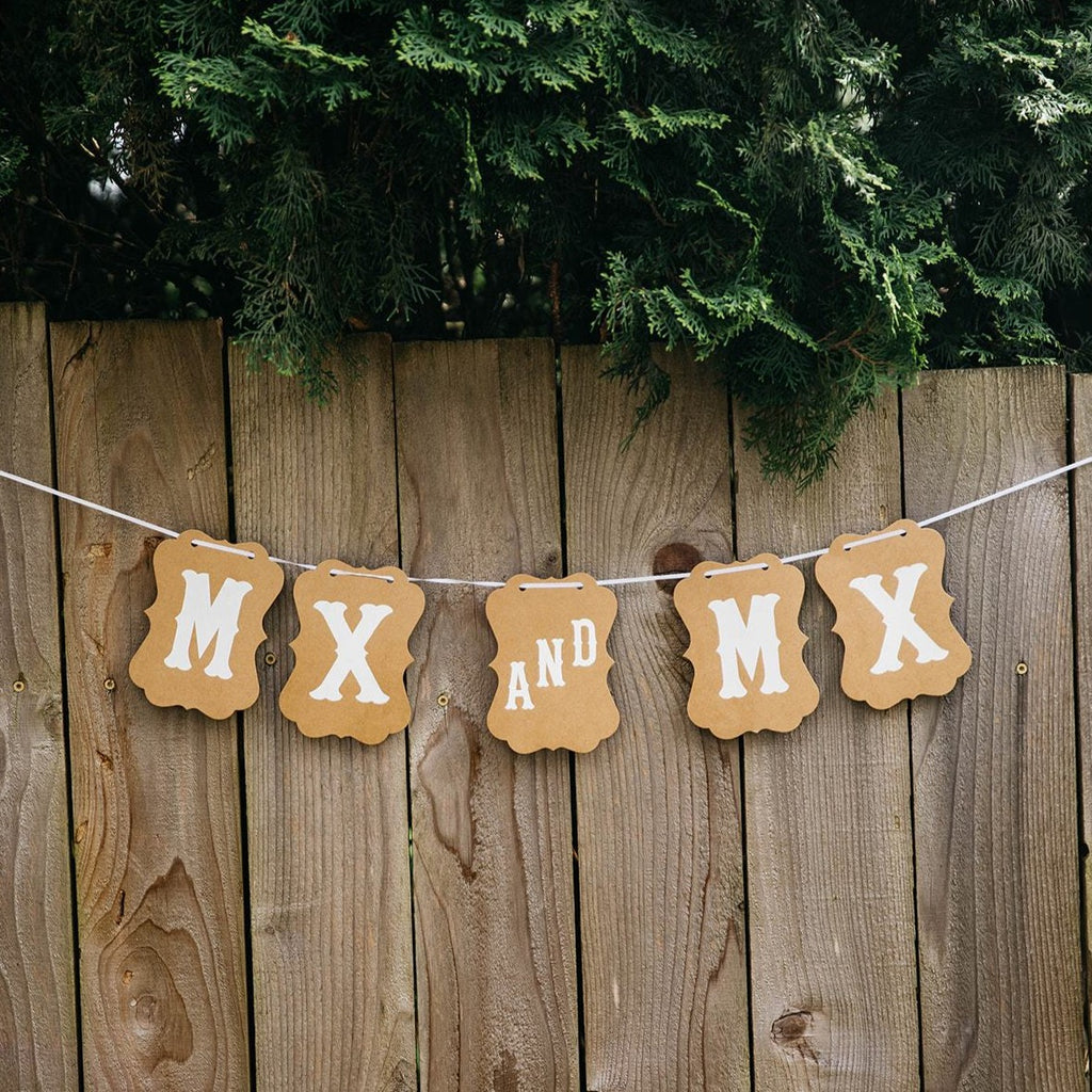 Mx and Mx Brown Craft Banner Hanging from Wooden Fence