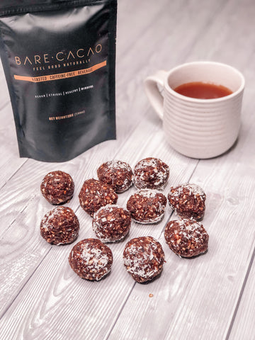 bare cacao bliss balls. peanut butter cacao coconut peanut butter ground almonds