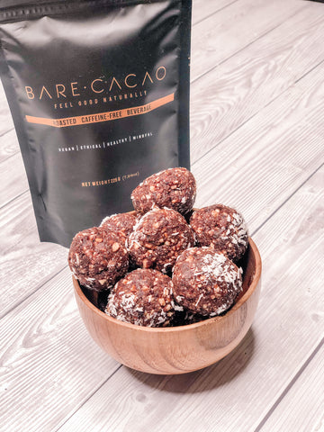 bare bare balls, cacao bowls in a wooden ball next to packet of bare cacao