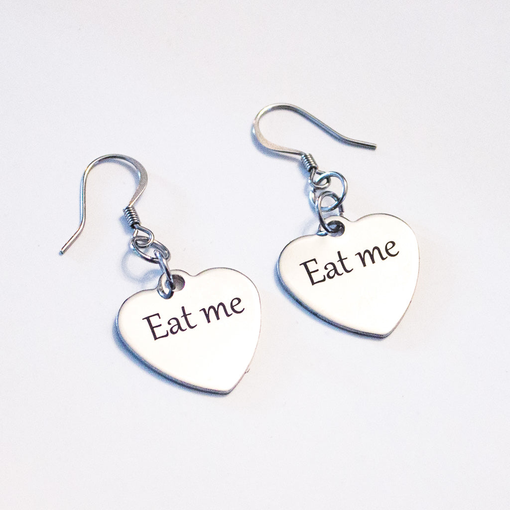 Eat me heart charm earrings