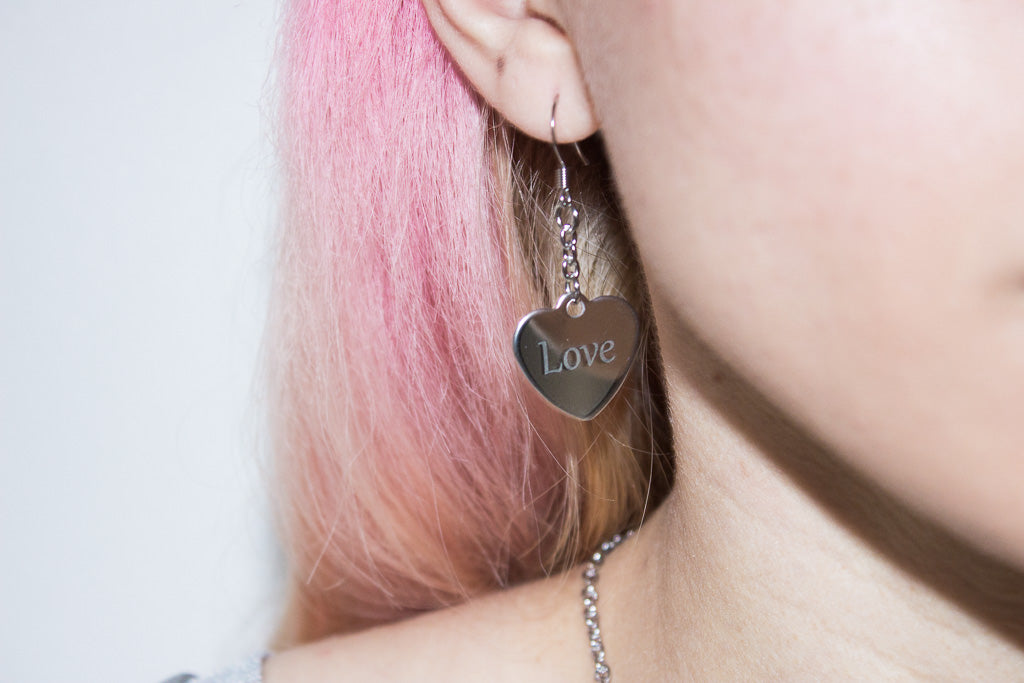 Love/Hate heart charm earrings
