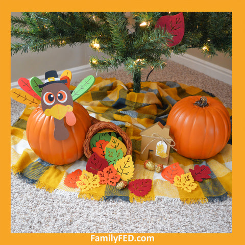 Place turkeys and leaves under a Thanksgiving tree to honor Thanksgiving with a turkey tree while enjoying the Christmas joy, light, and glow.
