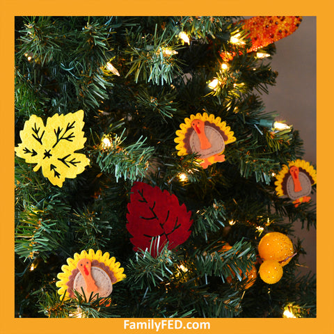 Use felt turkey stickers from the Dollar Tree to honor Thanksgiving with a turkey tree while enjoying the Christmas joy, light, and glow.