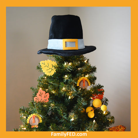 Top a Thanksgiving tree with a pilgrim hat to honor Thanksgiving with a turkey tree while enjoying the Christmas joy, light, and glow.