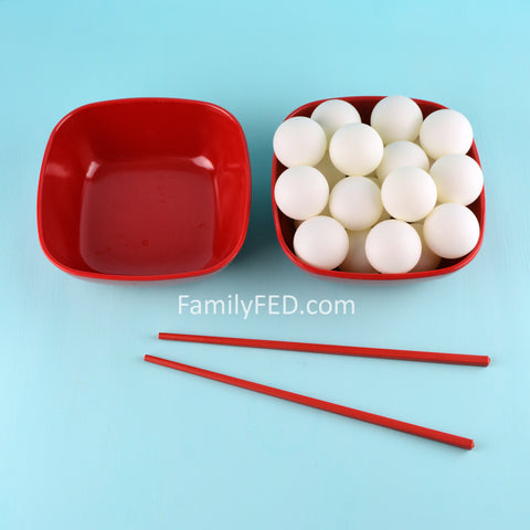 Fill one bowl with Ping-Pong balls and place an empty bowl next to it in the Backward Ball Drop game.