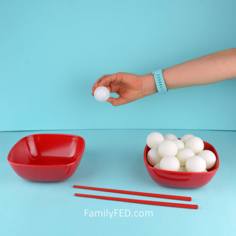 Make the Backward Ball Drop game easier by using hands instead of chopsticks.