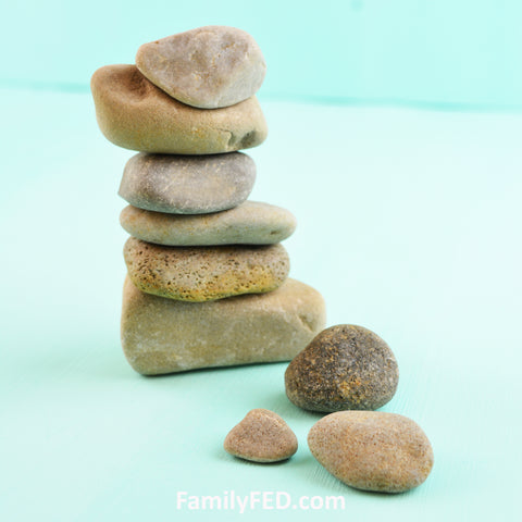 Unpainted rock cairn with rocks from the yard
