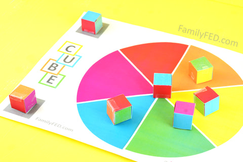 When the stack tumbles, score how many cubes land with each player's color choice faceup.