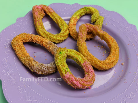 Decorate Disney churros as Easter eggs for a holiday Easter treat.