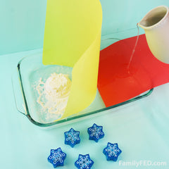 Easy DIY Frozen family game to protect Arendelle's castle! Pour water toward the flour.