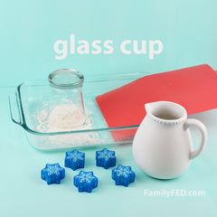 Easy DIY Frozen family game to protect Arendelle's castle! Try to block it with a glass cup.