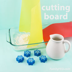 Easy DIY Frozen family game to protect Arendelle's castle! Try to block it with a cutting board.