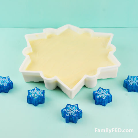 Melt ice cream into a snowflake silicone mold for a Disney Frozen 2 party