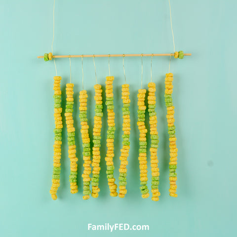 Make a wall hanging with skewer sticks and Fruit Loops. A Fruit Loops Arts and Crafts—a Creativity Exercise with Fun and Food