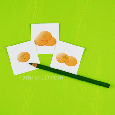 Draw a clover on some coin cards for a bonus turn in the Greedy Leprechaun St. Patrick's Day game by Family FED