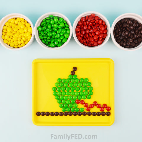Easy candy art project with M&Ms for a creativity exercise and idea to talk with your teens about problem-solving
