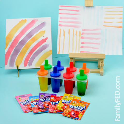 Paint with homemade Popsicles made from Kool-Aid for a perfect summertime arts and crafts activity!