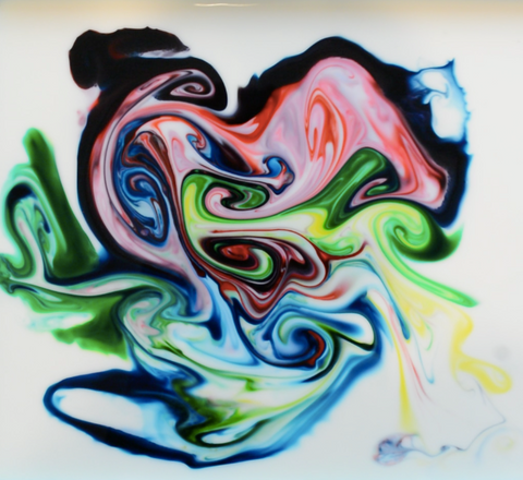 Art created by mixing milk, dish soap, and food coloring