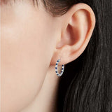 Luna Sapphire and Cubic Zirconia Hoops in Sterling Silver on model ear