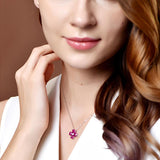 Ruby and Cubic Zirconia Flower Pendant in Sterling Silver on young model girl