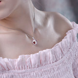 Ruby and Cubic Zirconia Necklace Pendant in Sterling Silver on the neck