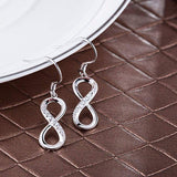 Silver Infinity Dangle Drop Earrings CZ Jewelry display