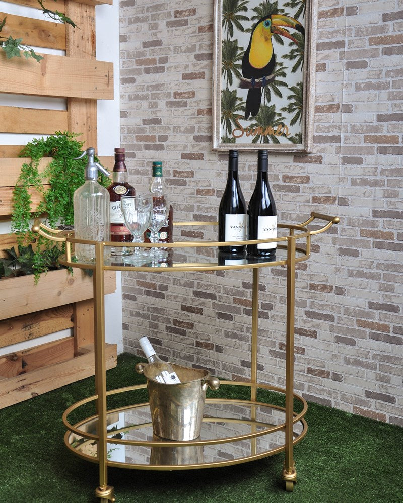 Luxe Brass And Mirror Oval Bar Cart