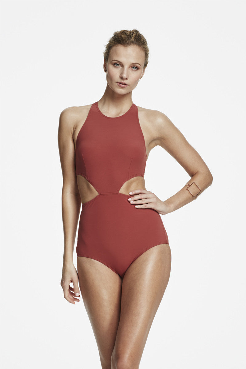 d86a0eea3c Rust cut out timeless swimsuits one piece. Take a minimalist approach with  this clean rust-colored cut-out one-piece.