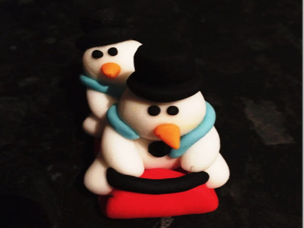 Edible snowmen on sleigh cake topper decoration