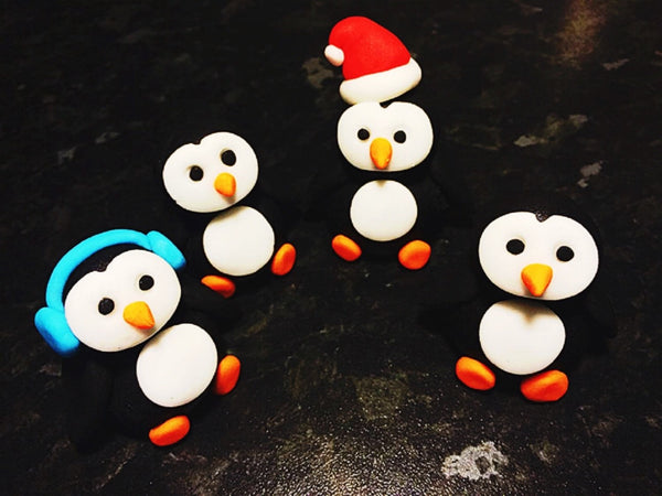Edible penguin set x4 Christmas cake topper decorations
