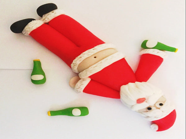 Edible drunk Santa comedy cake topper