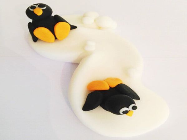 Edible penguin slope cake topper