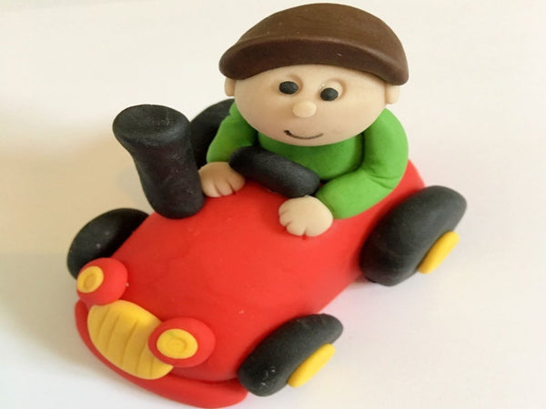 man on tractor cake topper