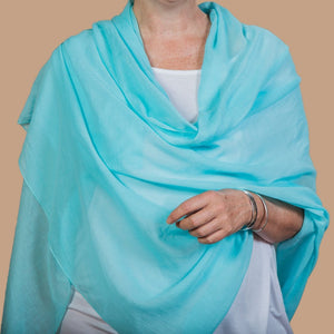 female wearing aqua wrap
