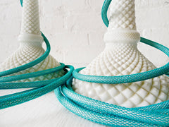 Pair of Vintage White Milk Glass Diamond Cut Candlestick Lamps with Aqua Textile Cord