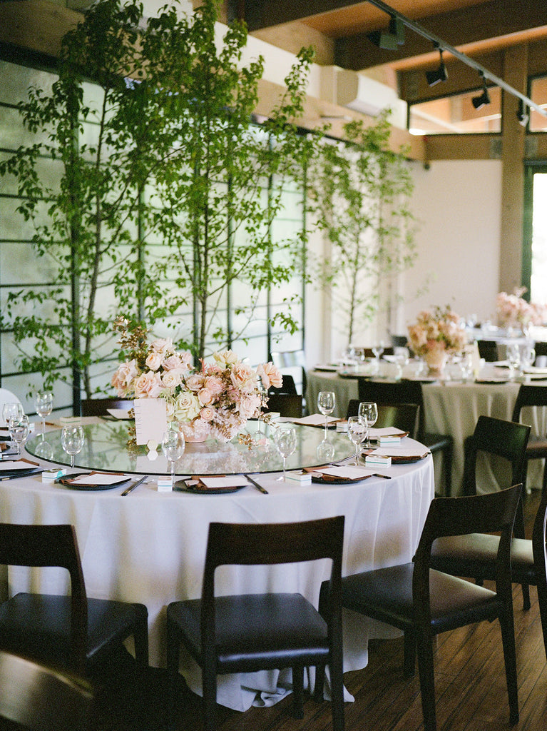 Peach floral wedding table styling