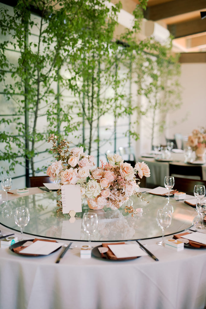 Rust, ivory and peach wedding table styling