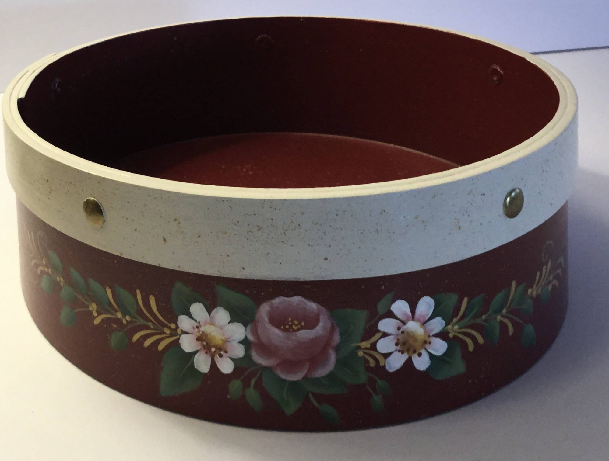 A Round Bentwood Box Painted in Red with pink Roses and Daisies on Both Sides
