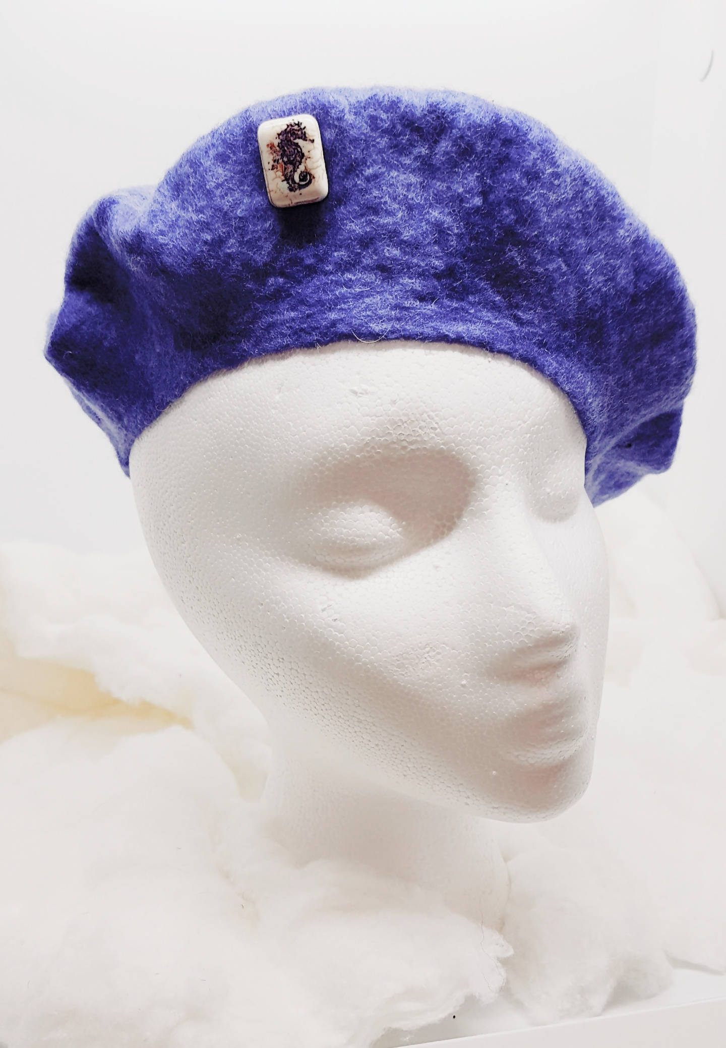 A youth beret with sea-horse bead