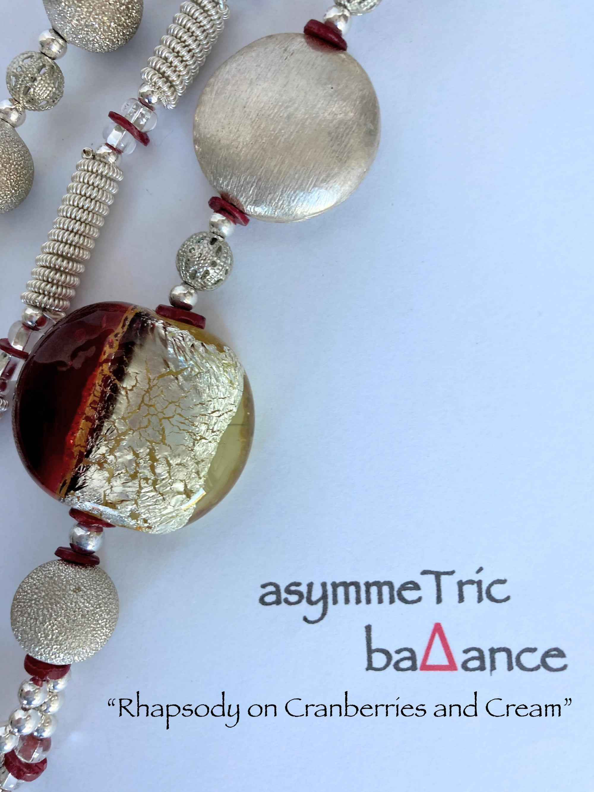 Rapsody on Cranberries and Cream: an symmetric statement necklace