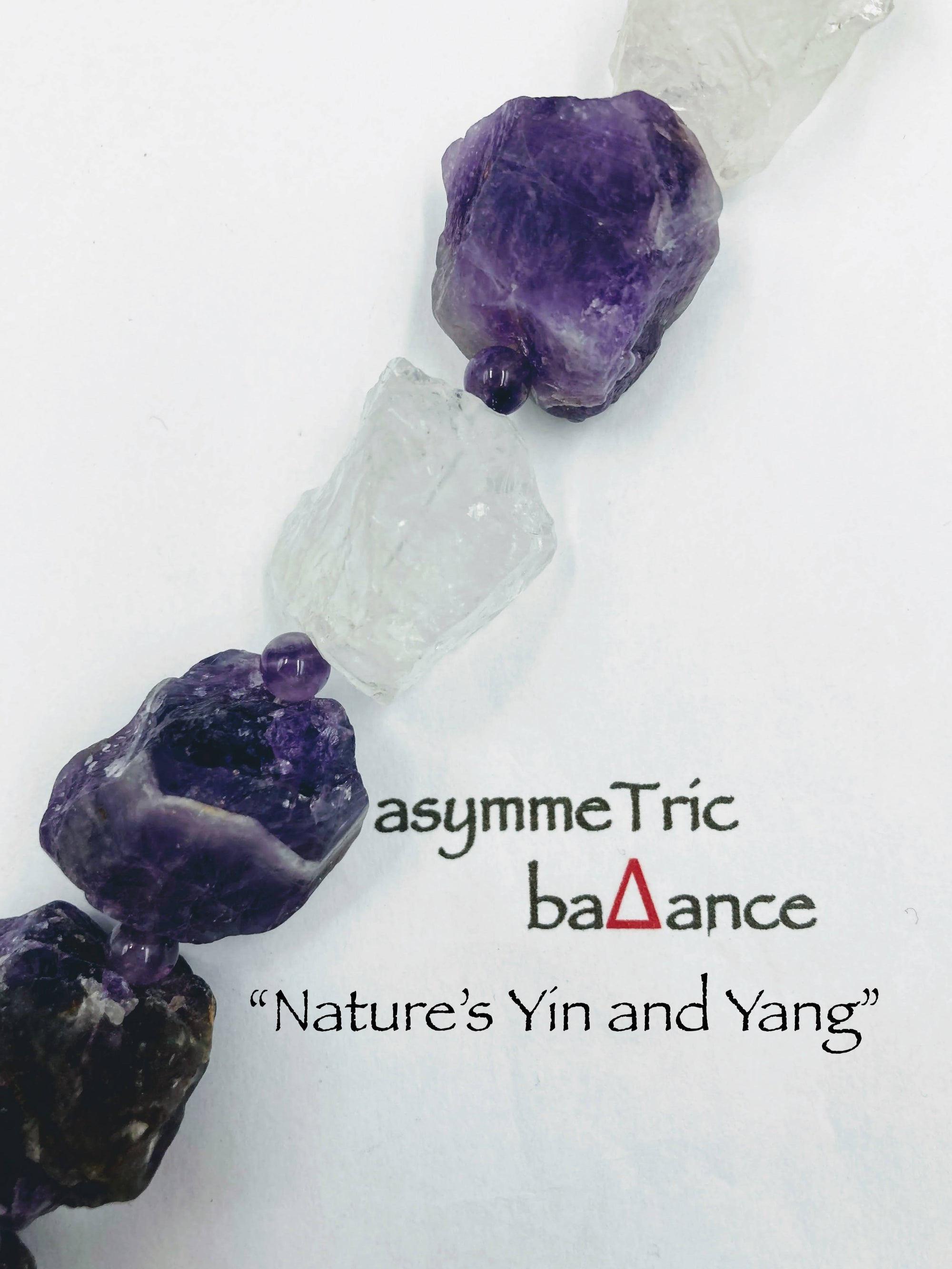 Nature's Yin and Yang: raw amethyst and crystal quartz chunks