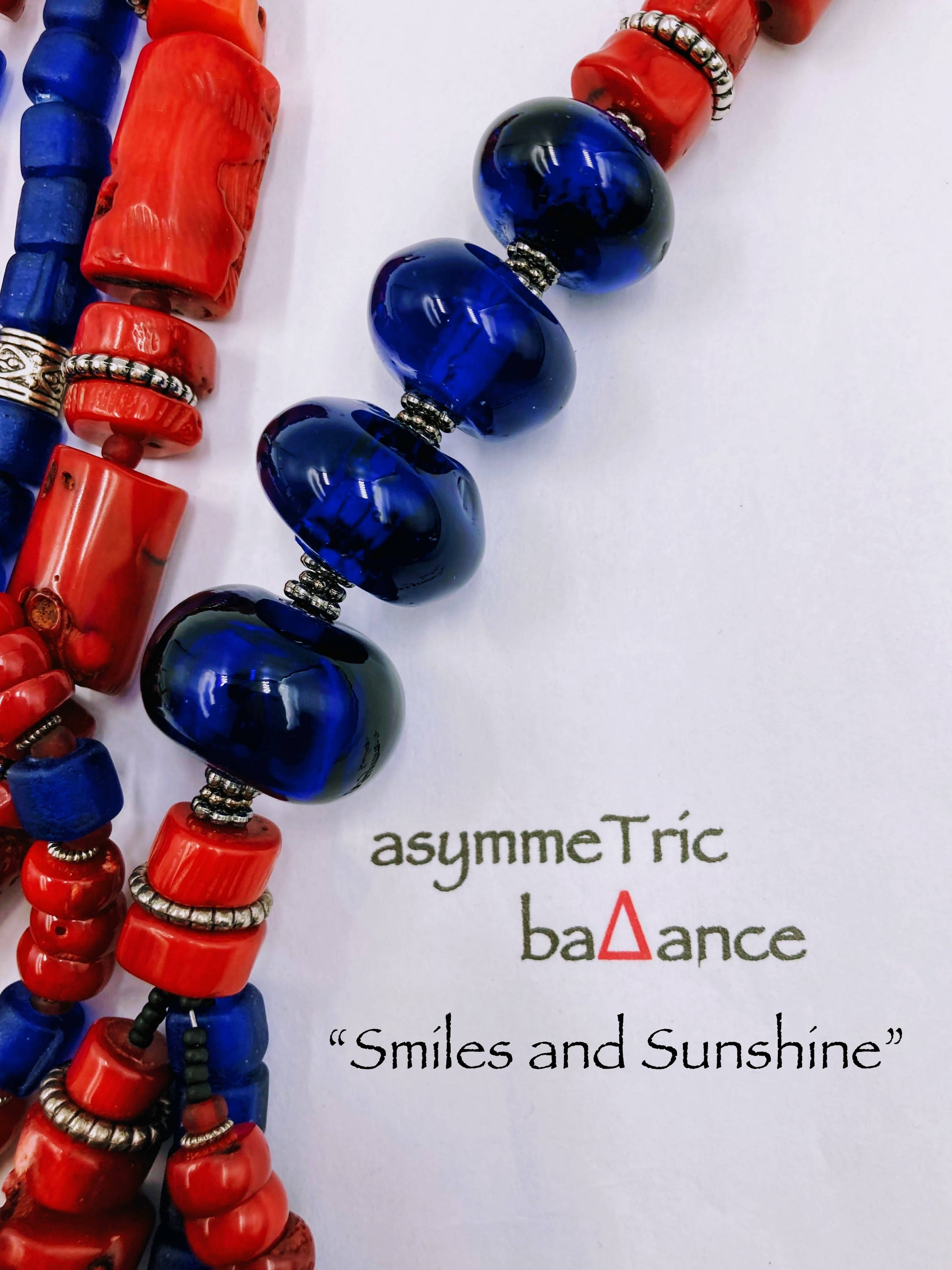 Smiles and Sunshine: red bamboo coral and blue glass statement necklace and matching bracelet