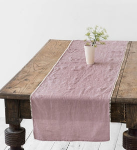 Linen table runner with pom pom detail