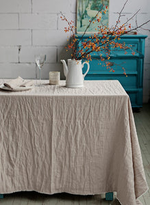 Linen tablecloth with pom pom trim