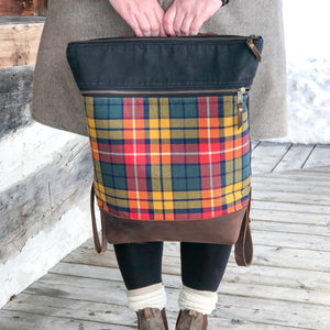 Buchanan tartan backpack being held