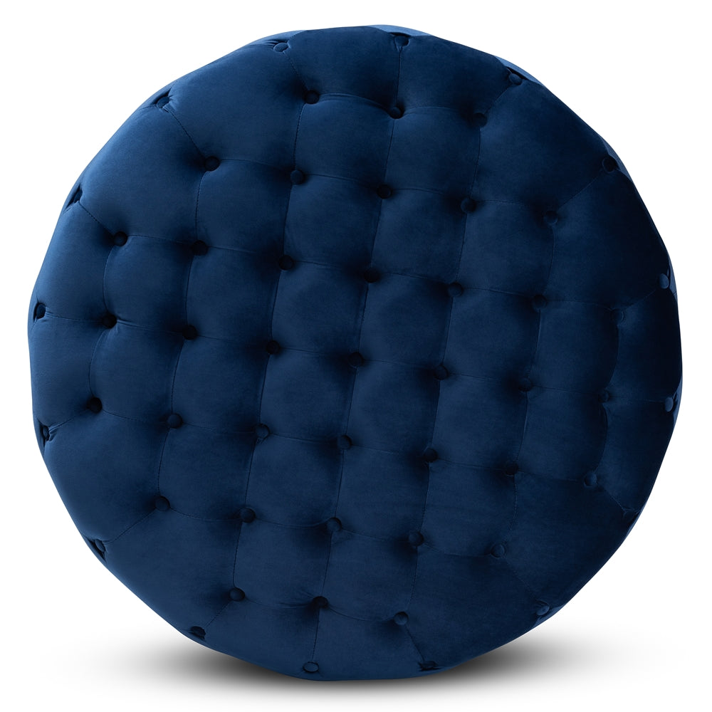 SASHA GLAM AND LUXE ROYAL BLUE VELVET FABRIC UPHOLSTERED GOLD FINISHED ROUND COCKTAIL OTTOMAN