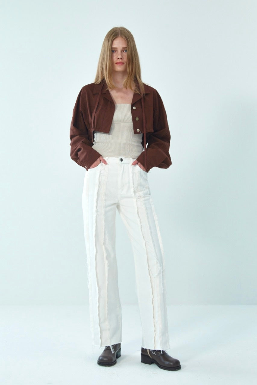 RAW-EDGE PANELLED JEANS BY THEOPEN PRODUCT IN WHITE