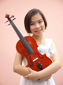 Young girl holding a violin