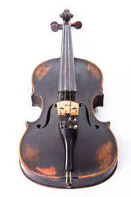 An old violin on a white background